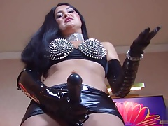 dominatrix in leather predominates you