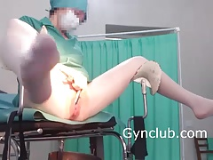 nurse masturbating on a gynecological tabouret in  gloves