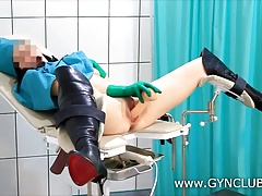 Dark-haired nurse masturbates in the doctor's office