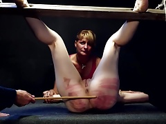 Ruthless flogging for blonde and her