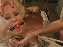 Bound and ball-gagged    gets used as a sex plaything