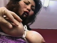 Playsome lady is penetrating large dildo on her chair