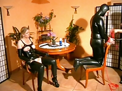 Dominatrix pokes victim duo