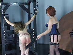 Youthfull cheerleader dark-haired gets spanked and pussy  by older lesbo