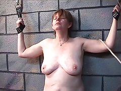 Thick lady gets her funbags pulverized in wood in dungeon play with older master