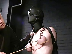 masked victim tormented and filled