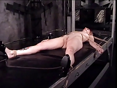 Cutie in with a cute rack,  and has her labia taunted by her tormentor