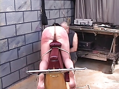 D-cup jiggly-assed dark-haired slave gets paddled, caned and roped