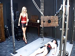 Spandex  whips strapped up rubber sissy slave in dungeon space