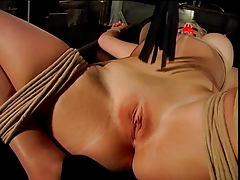 Hefty tits blonde, strapped and gagged, gets her cunt   by her